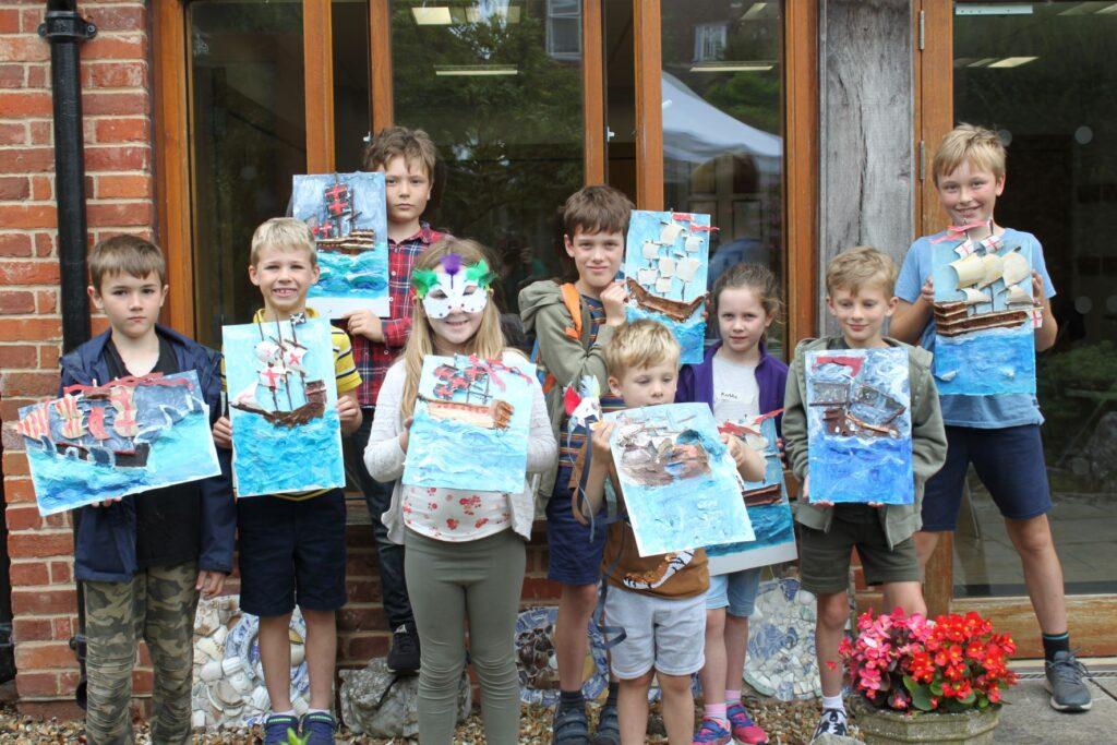 Children displaying their Galleons